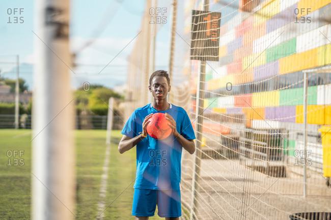 Black teenager on football field