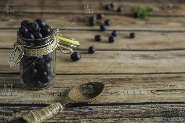 Tasty bilberry on wooden surface