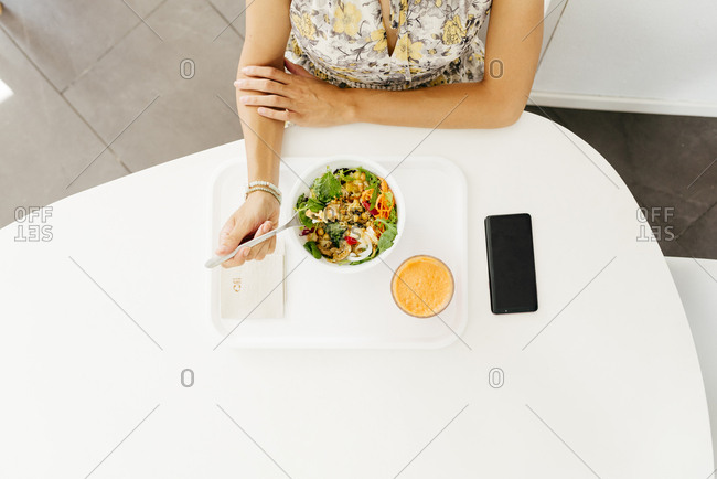 Woman with healthy food sitting in cafe