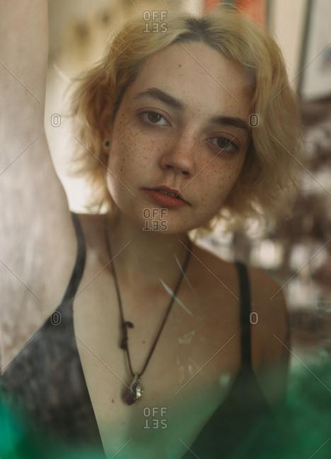 Charming melancholy woman looking at camera