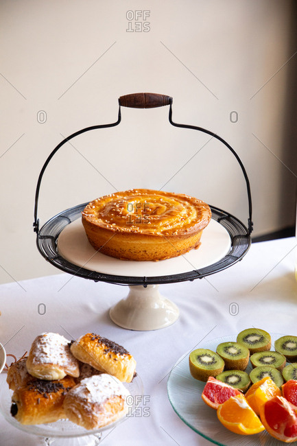 From above stylish table mate with grip and tasty pie on table with dishes