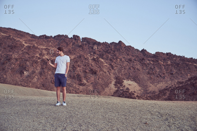 Man using cell phone in Teide, Spain