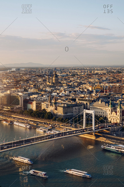 From above amazing landscape of densely populated city and large bridge over river in Budapest