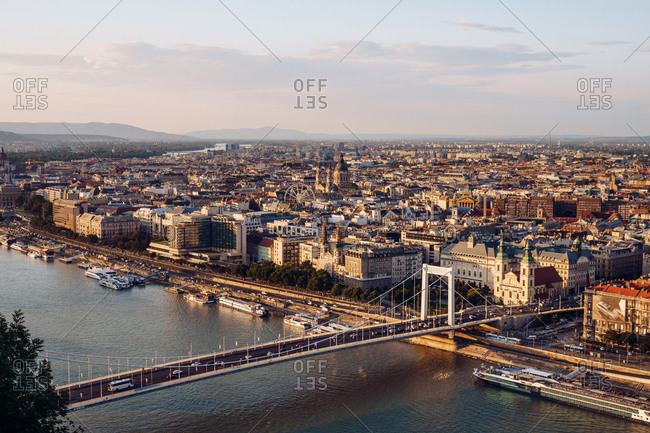 Budapest, Hungary  - September 13, 2019: Boats on city channel flowing under bridge in bright day