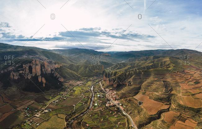 Aerial view of mountain chain and village landscape in Islallana, La Rioja, Spain