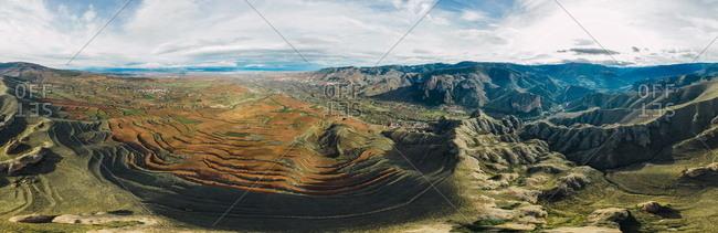 Aerial panoramic 180� view of mountain chain and village landscape in Islallana, La Rioja, Spain