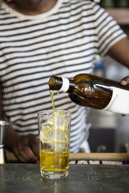 Bartender making a cocktail - Offset