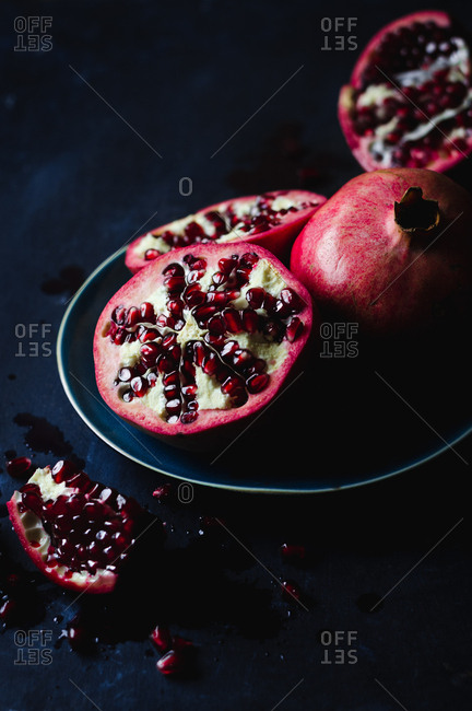 Still Life of Opened Pomegranates in Dark and Moody Background