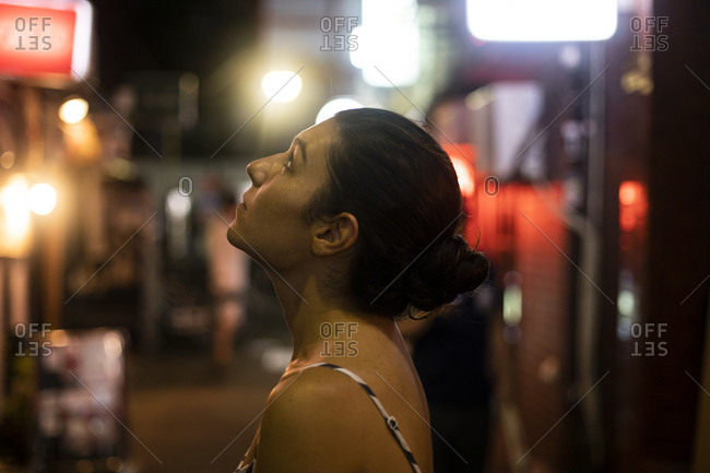 Portrait of a young woman admiring the streets of Tokyo- Japan