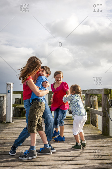 Happy family on a pier- Ahrenshoop- Mecklenburg-Western Pomerania- Germany