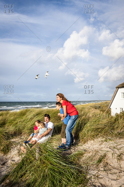 Family in a beach dune looking at view- Darss- Mecklenburg-Western Pomerania- Germany