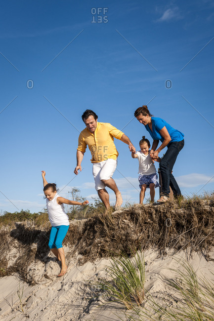 Family running in a beach dune- Darss- Mecklenburg-Western Pomerania- Germany