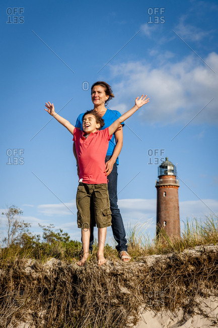 Happy boy with mother standing in a beach dune- Darss- Mecklenburg-Western Pomerania- Germany