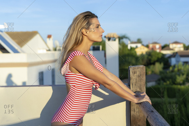 Portrait of woman standing on roof terrace looking at distance- Sevilla- Spain