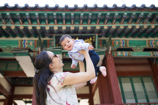 Mother and baby girl visiting pagoda in the Secret Garden- Changdeokgung- Seoul- South Korea