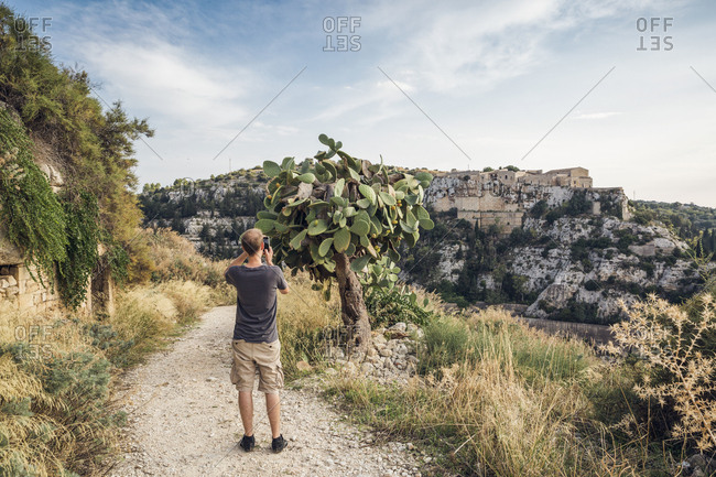 Hiker photographing cactus- Scicli- Sicily