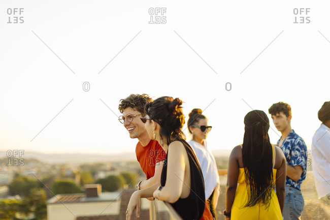 Group of happy multi-ethnic friends celebrating a party in the evening