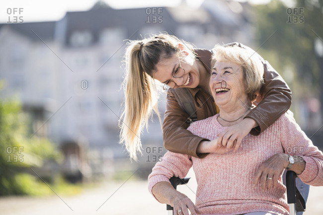 Granddaughter and her grandmother laughing