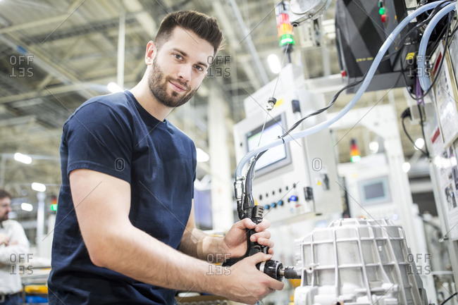Portrait of a confident man working in a modern factory