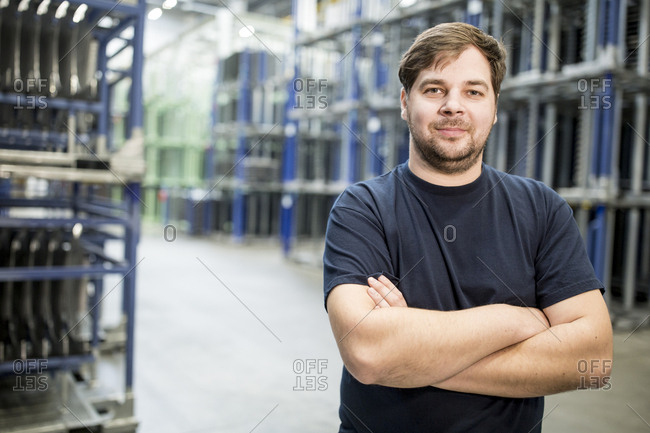 Portrait of confident worker in a factory warehouse