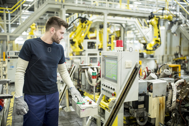 Man working in a modern factory operating a machine