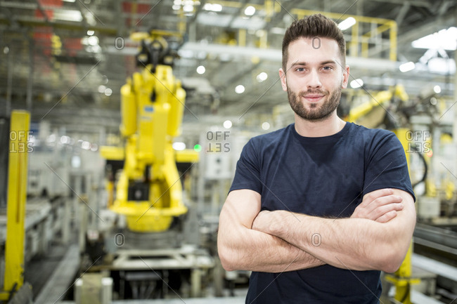 Portrait of confident worker in a modern factory