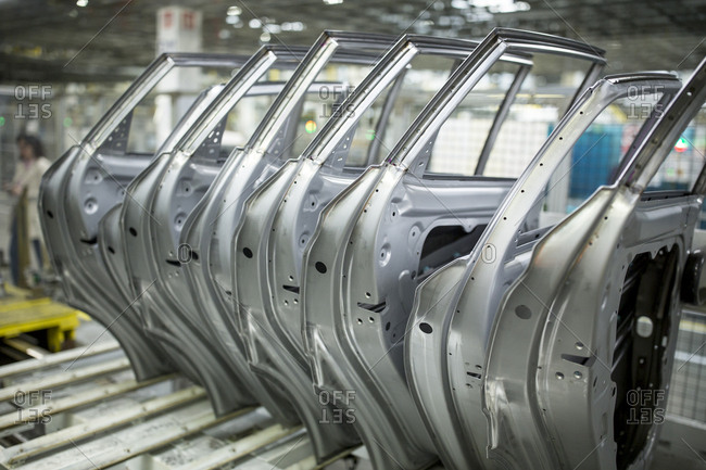Modern automatized car production in a factory- row of car doors