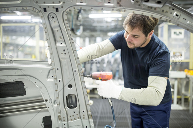 Man working in modern car factory