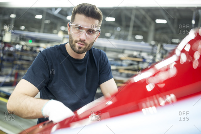 Portrait of confident man working in modern car factory