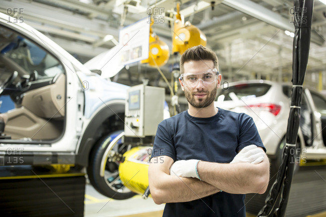 Portrait of confident worker in modern car factory