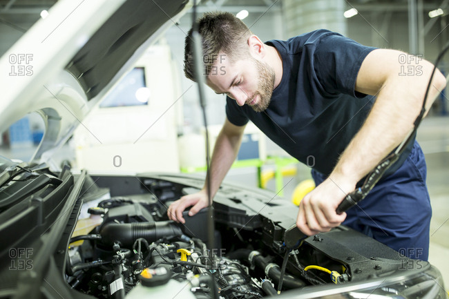 Man working on car in modern factory