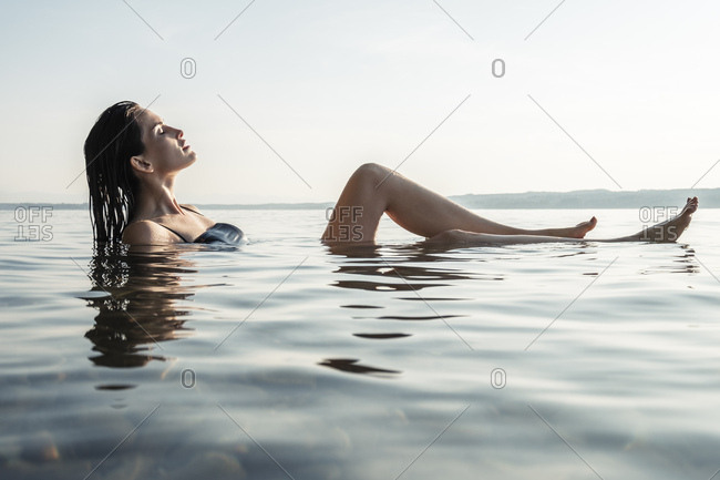 Young woman bathing in Lake Starnberg- Germany