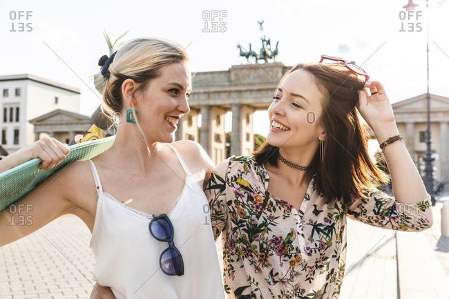 Portrait of two best friends in front of Brandenburger Tor- Berlin- Germany