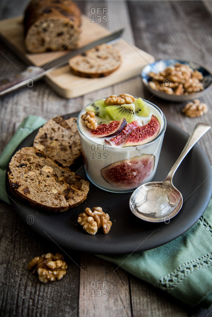 Yogurt with fresh figs and raisins served with German fruit bread and walnuts