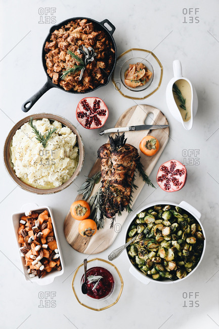 Overhead view of a Thanksgiving spread on a white table