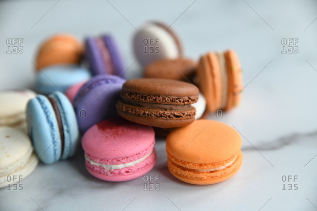 Detail of colorful macaron cookies on marble surface