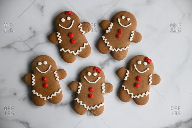 Gingerbread man cookies on marble surface