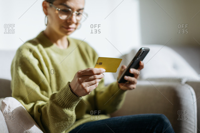Woman using phone to make credit card payment