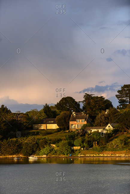 Sunset over house on The Island Monks, Ile-aux-Moines, France