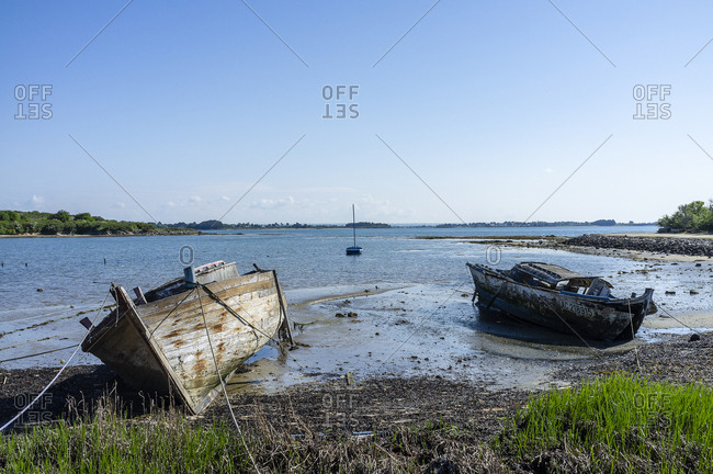 Old moored boats on the coast of The Island Monks, Ile-aux-Moines, France