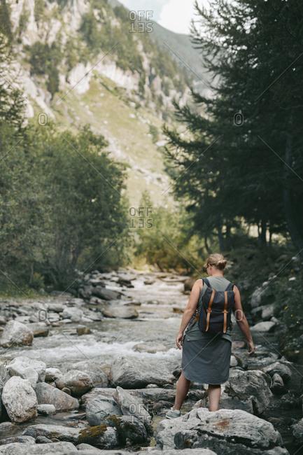 Woman crossing river