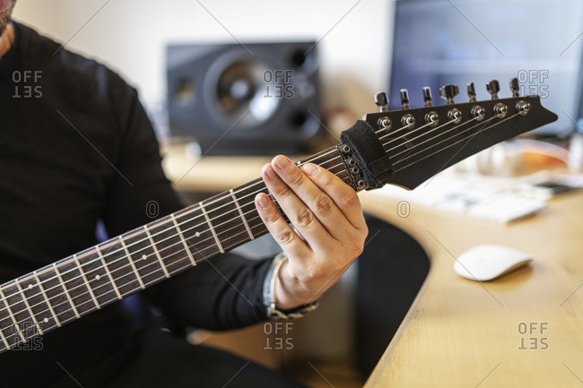 Hand on guitar neck