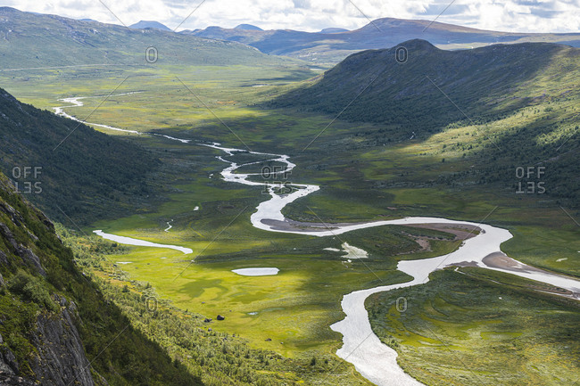 View of winding river in mountains