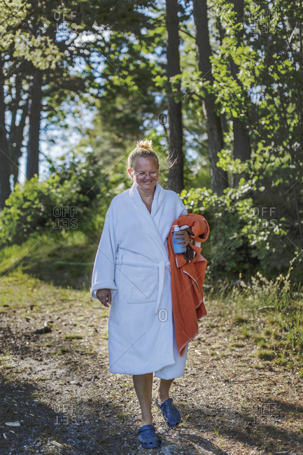 Woman wearing dressing gown holding towel