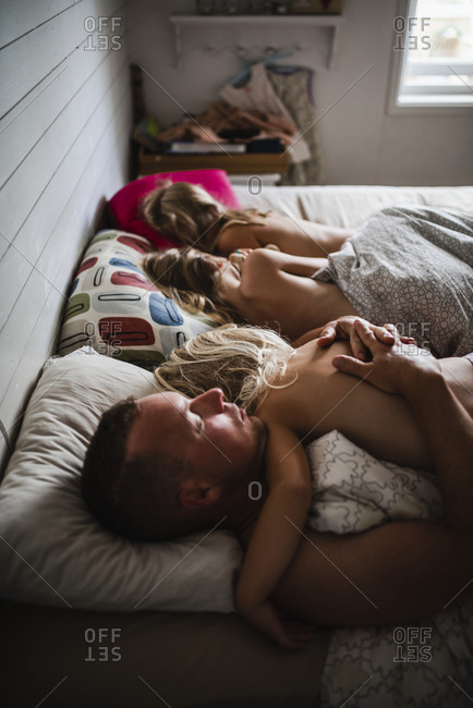 Father and kids sleeping in bed