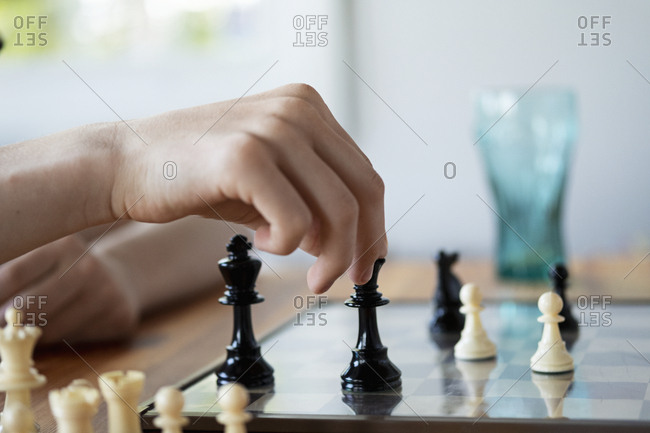 Hand holding chess piece