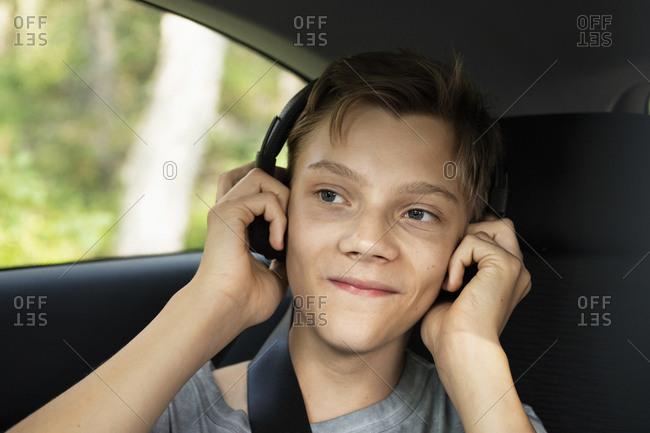 Boy in car listening music
