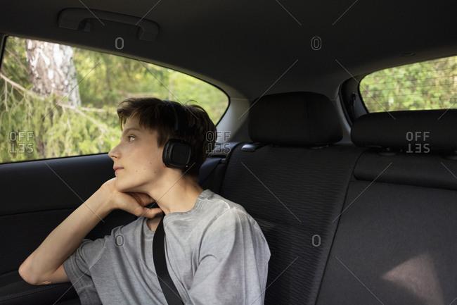 Boy in car looking through mirror