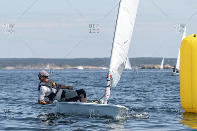 Man sailing boat on sea