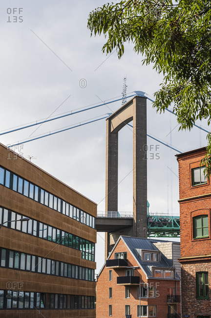 View of buildings with suspension bridge on background